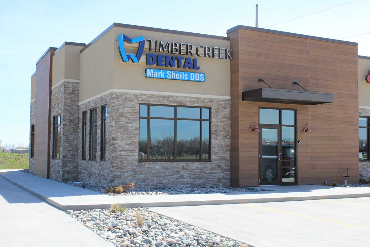 Timber Creek Dental exterior in EIFS stucco and stone work by OTXteriors