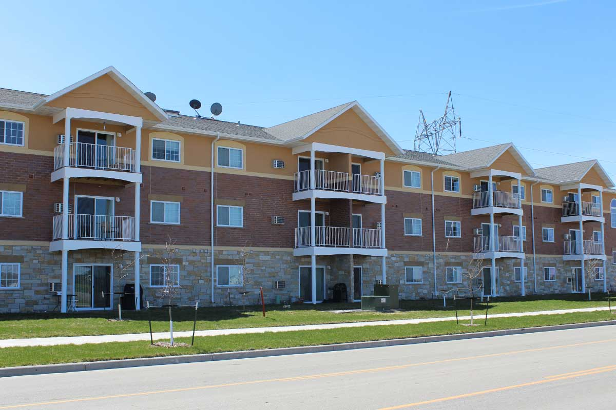 apartment with eifs stucco, vinyl and stone done by OTXteriors in Fargo