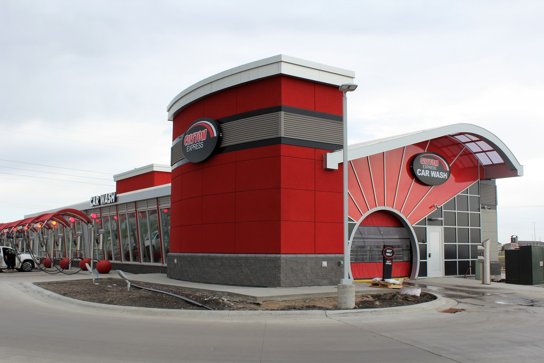 Custom Express Car Wash in Fargo with red EIFS stucco work by OTXteriors