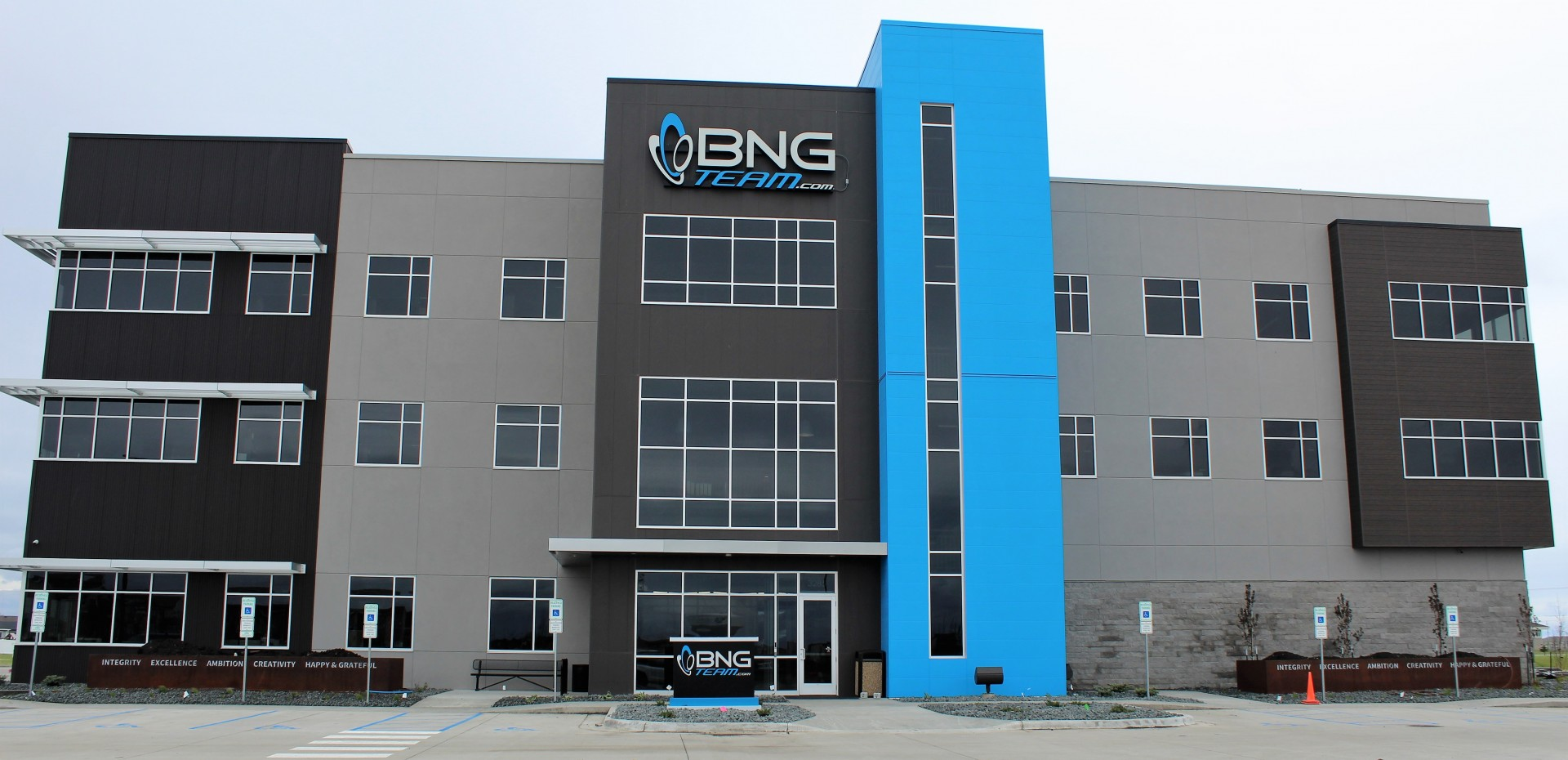blue and taupe EIFS stucco work by OTXteriors on BNG Team building in Fargo