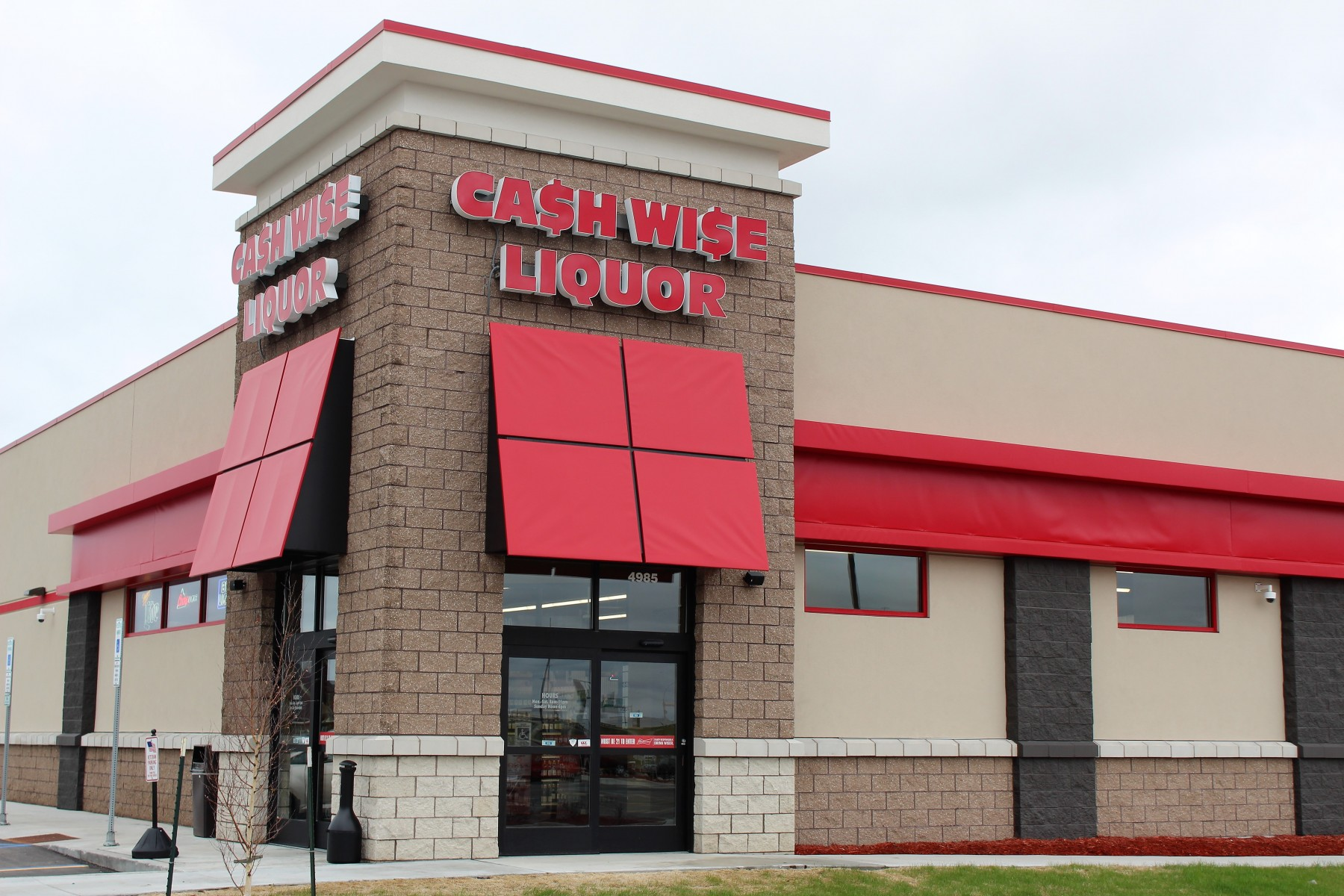 Cash Wise Liquors with tan and brown brick and stucco exterior in Fargo North Dakota