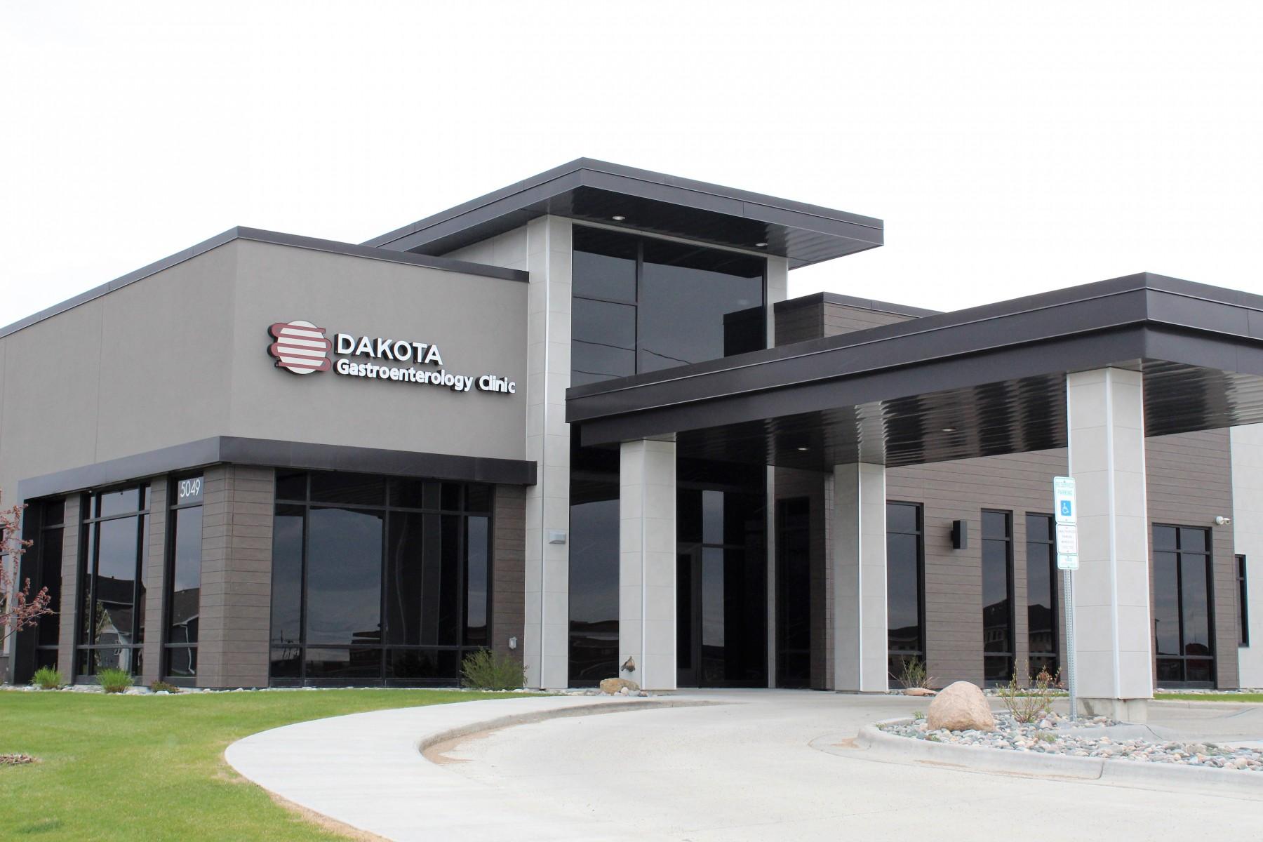 Modern design with exterior stone and brick by OTXteriors on Dakota Gasteroenterology Clinic in Fargo North Dakota