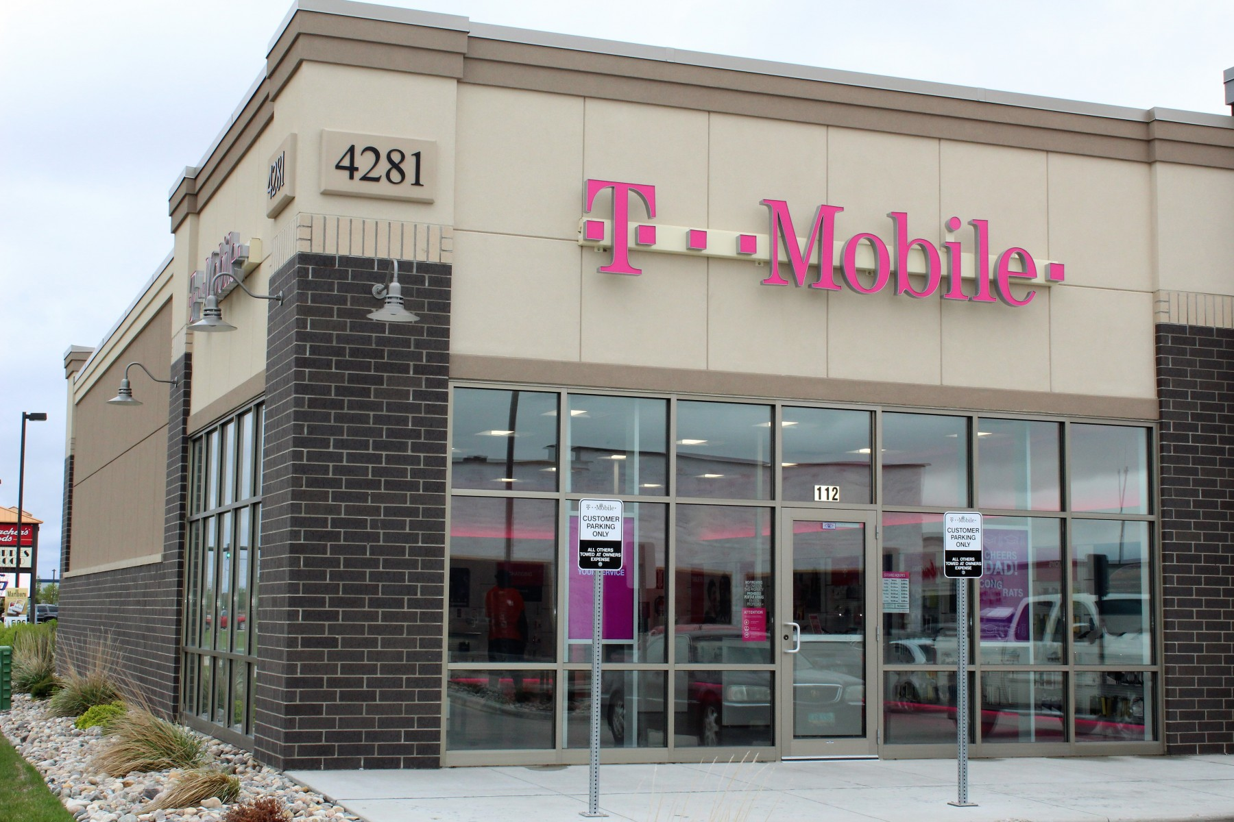 T-Mobile in the 45th Street South strip mall in Fargo North Dakota showing brick and stucco EIFS work by OTXteriors