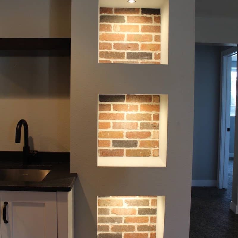 brick accent behind wall alcoves by OTXteriors in Fargo recessed wall niche