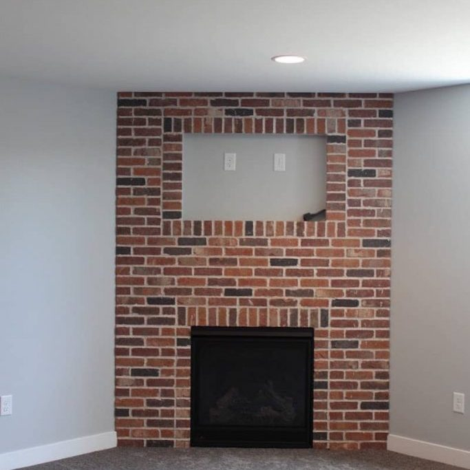 traditional brick fireplace by OTXteriors in Fargo